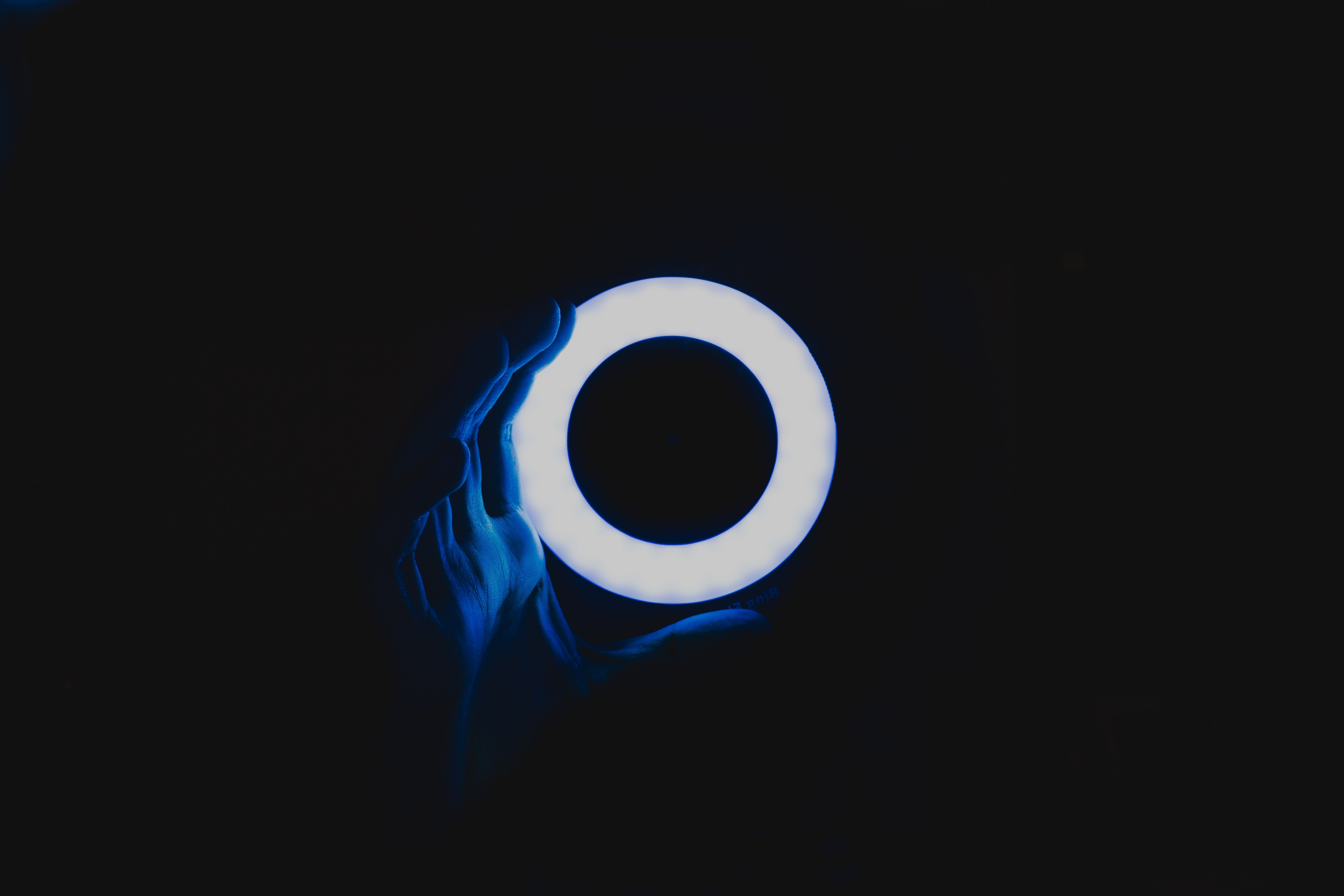 Hand holding a circular lamp